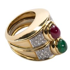 A substantial 18 karat yellow gold ring set with one cabochon oval emerald and one cabochon oval ruby with diamond pavé accents. By David Webb. Signed WEBB. Size 6-1/2 (re-sizable inner band for small