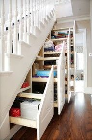 In my dream house, I would do exactly this on the side of  my staircase.  Looks great, and what storage! Great idea! -Repinned by Shawn House onto Beautiful Home