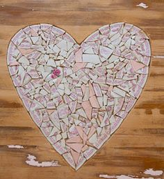 Mosaic inlay on a table top.  Wood is chiseled out to create inlay shape and the mosaic is pieced in.