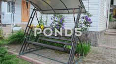 Video footage. Pond5.com. Swing and house.    #outdoor #tree #chair #table #leisure #nobody #deck #pot #new #holiday #built #outside #umbrella #door #porch #wood #window #wall #furniture #place #stair #garden #siding #vacations #home #terrace #house #yard #wooden #veranda #scene #back #romance #swing #residential #tranquil #gazebo #construction #structure #summertime #rustic #relaxation #gathering #flower #day #exterior #summer  #Video #footage #stock #pond5