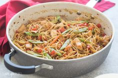 An easy, one pot version of Chicken Chow Mein - loaded with peppers, cabbage, peas and carrots it's an easy, healthy meal the whole family loves! Say no to takeout ;) Includes step by step recipe video.   one pot pasta   one pot meal   one pan meal   easy dinner recipe   healthy dinner recipe   family friendly   takeout   Chinese   Asian