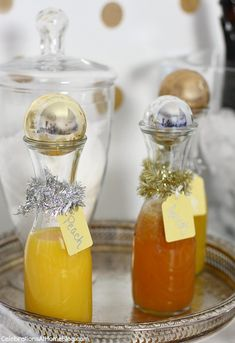Top off bottles & carafes with ball ornaments - nye bubbly bar, fruit nectars
