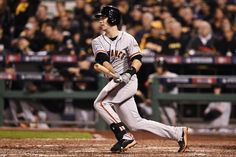 PITTSBURGH, PA - OCTOBER 01: Buster Posey #28 of the San Francisco Giants singles in the seventh inning against the Pittsburgh Pirates during the National League Wild Card game at PNC Park on October 1, 2014 in Pittsburgh, Pennsylvania. (Photo by Jason Miller/Getty Images)