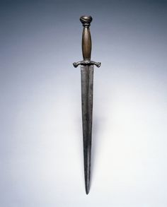 Dated: mid 16th century Culture: German Medium: steel; elk horn grip Measurements: overall - l:37.80 cm (l:14 7/8 inches) Wt: .22 kg. Blade - l:27.70 cm (l:10 7/8 inches). Quillions - w:6.50 cm (w:2 1/2 inches)