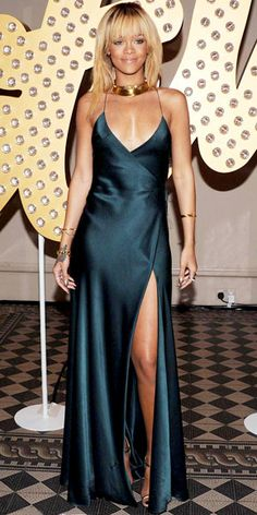 Rihanna  WHAT SHE WORE  Rihanna made an entrance at a Stella McCartney London Fashion Week bash in the label's slinky gown and gold accessories.