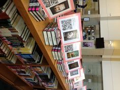 A tech-inspired, creative library display idea: link to book trailers through QR codes!