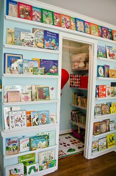 This photo provided by ProjectNursery.com shows a book wall as part of a kids' homework hub that can include a reading nook too. Create a co...