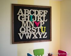 """This ginormous """"I Heart U"""" wooden alphabet wall decor is perfect for filling a large wall in a playroom or child's room!"""
