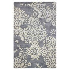 Add a pop of pattern to your living room or den with this hand-tufted wool and art silk rug, showcasing a floral motif for stylish appeal.  ...