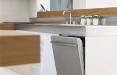 Crystal, large pans and even stockpots are no match for the Encore dishwashers. The unique racks and cycles have been redesigned to accommodate items that have previously been difficult to wash in a standard dishwasher.    Play hide and seek with our Asko dishwashers. Beautifully integrated within our kitchen vignettes, you'll have to seek them out…and they're so whisper quiet, they won't even give you a hint.