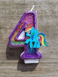 My Little Pony birthday candle, My Little Pony party, Rainbow Dash birthday by LilMonkeyStitchesWV on Etsy https://www.etsy.com/listing/551142860/my-little-pony-birthday-candle-my-little
