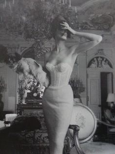 dressing room chandelier. lingerie fashion photographed by jerry plucer-sarna, 1950s.