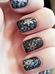 Snowflake nails on matte black, with glitter.  That is absolutely GORGEOUS!!