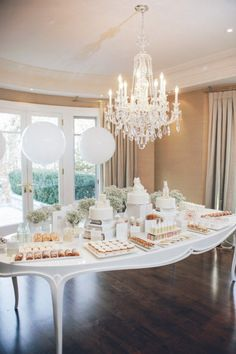 white baby shower, would be cute as a gender reveal and switch out the balloons either pink or blue