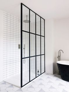 Subtle, black, steel frames in the bathroom