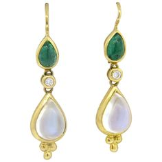 Temple St. Clair Moonstone Emerald Diamond Gold Drop Earrings. A pair of new 18k yellow gold drop earrings, crafted by Temple St. Clair, set with emerald and moonstone cabochons and 0.07ctw in G/VS diamonds. Earrings 35mm x 8mm. Marked with Temple mark and 750. Weight - 5 grams