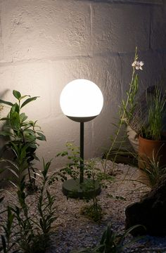 The Fermob Mooon table lamp lighting up a contemporary, eco-friendly dry garden in a raised bed made from railway sleepers - outdoor lighting - usb chargeable garden lights Railway Sleepers, Dry Garden, Garden Nursery, Hardy Perennials, Raised Bed, How To Make Bed, Shade Garden, Outdoor Lighting, Planting Flowers