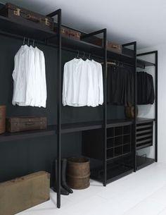 guardaropas estilo contemporaneo de francia para hombres color negro con contraste en las paredes blancas
