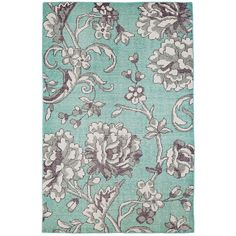 In a cool shade of aqua covered by a sprawling ivory and grey floral design, our Edie wool-blend area rug is stunning yet demure. Cotton and wool are first knotted and then sheared by hand, which creates a plush feel, unique mottled appearance, and excellent durability. This rug is an ideal backdrop for your master bedroom, family room, or dining room.