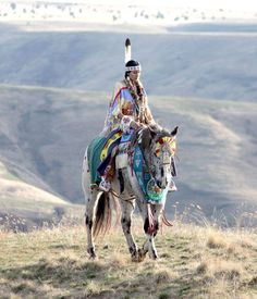 native winnebago regalia  woman  horse