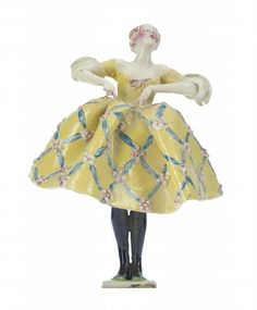 Earthenware figure of a girl wearing a low cut yellow dress with diaper pattern in blue and pink, entitled 'The Good Humoured Lady': English, Chelsea Cheyne