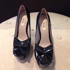 Black heels bow in the front open toe New in box. Lining & rubber outsole Olsenboye Shoes Heels
