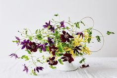Emily Thompson - arrangement with clematis and gloriosa lilies