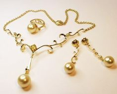 The amazing set I completely handmade for my apprentice design awards that won me 2008 JAA apprentice of the year.  Gorgeous golden pearls in solid hand wrought 18ct gold and set with yellow Australian Sapphires.  Necklace, earrings and ring set.  These pieces have been purchased x