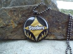 Check out this item in my Etsy shop https://www.etsy.com/listing/497219681/pittsburgh-steelers-glass-pendant