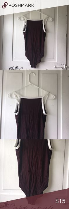Soft & Sexy Low back Bodysuit Soft & Sexy low back bodysuit Im color reason red | Im good condition | Size Small | Brand: American Eagle Essentials | Soft & Sexy Jersey First Essentials | One-piece | Hi-neck, Low back | Three button closure | 🌟Please see all pictures, ask questions, read description before making your purchase American Eagle Outfitters Tops