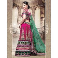 Rani with Peacock Green color Net Lehnga choli with dupatta