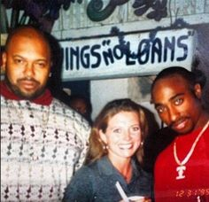 Tupac and Suge Knight with a fan