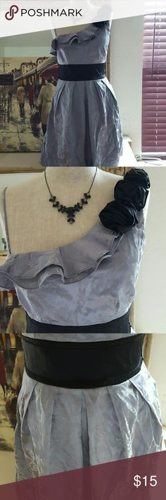 Silver dress Cute silver one shoulder dress with pockets. Material listed in picture. Has a tie that goes around the back. There are a couple of loose threads but in over all great condition. Speechless Dresses One Shoulder