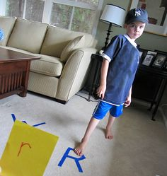 Letter Match Gross Motor-Gross motor letter recognition game. Great for kinesthetic learners. Hold up a letter and kiddo has to stand on the matching letter. Could also do this for numbers or colors for little ones