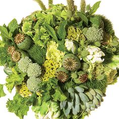 Hydrangeas, cockscomb, Supergreen roses, parrot tulips, trick dianthus, succulents, fountain grass, poppy pods, geraniums, mint, lily grass, thistle, and allium