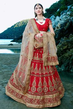 Red designer Indian lehenga choli for ring ceremony