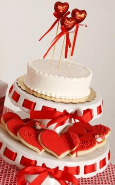 Gorgeous Valentine's Day cake and heart cookies! See more party ideas at CatchMyParty.com. #valentinesday #cake