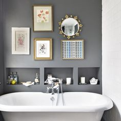 Refresh your bathroom with a display of artworks in the bathroom.