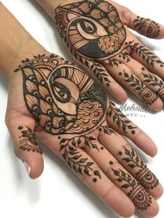 Best Peacock Mehndi Designs - Classical Indian Mehndi designs have a few elements which are much loved, traditional, yet unique in their rendering over the passage of time. These include tikkas, mango motifs, florals and peacocks. Henna Peacock, Peacock Mehndi Designs, Pakistani Mehndi Designs, Back Hand Mehndi Designs, Bridal Mehndi Designs, Mehandi Designs, Henna Palm Designs, Peacock Design, Bridal Henna