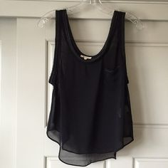Sheer Tank Top Sheer black LAmade tank top with pocket, neck and arm holes have chain detail. Super cute for a going out top, just needs a cute bralette underneath! Size XS fits more S/M LAmade Tops Tank Tops