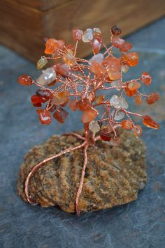 Carnelian agate and copper wire tree on a brain coral fossil rock by FirePenguinDesigns on Etsy