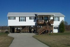 1000 images about mobile homes on pinterest mobile for Manufactured home on stilts