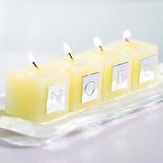 Candle Greetings - Share greetings anywhere in the home. Stick adhesive scrapbooking letters to small candles. Line up the candles to spell a message