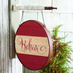 """Create a striking focal point on your covered porch or inside your home with our Hanging Believe Sign. The bracket for hanging is sold separately. Choose from our wide selection of signs for a quick and easy change with the seasons. Measures 14""""Dia. #country #christmas #sign"""