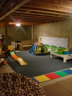 Play area in unfinished basement - great idea. Now to just clean it out and make it a useful room!