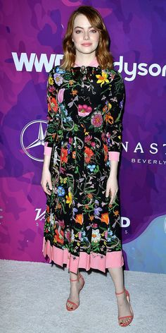 Emma Stone stepped into Gucci's eccentric Garden of Eden when she selected this wild rose and snake-printed pleated number by the reigning maximalist brand for the 2nd Annual StyleMaker Awards. She picked up on the millennial pink from the hemline and carried it over to her shoes, with a pair of a sandals in the same shade.