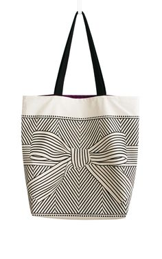 Big bow large canvas tote bag. Could easily make using a standard tote from Michael's and draw the pattern with Sharpie.