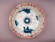 Zhangzhou Export Ware porcelain dish with deep rounded sides and everted rim. Swatow type, with red, turquoise and black overglaze enamels. Marine compass in centre, with the characters 'tai ji' (supreme ultimate) and others representing the Ten Celestial Stems and the Twelve Terrestrial Branches. Fish, wave pattern and boat in the cavetto. Eight Trigrams around rim. (Ming dynasty) Mariners Compass, Red Turquoise, Wave Pattern, Enamels, British Museum, Stems, Branches, Supreme, Centre