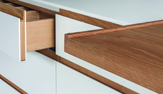 A close-up detail of a Corian-clad drawer front. So much more robust than spray-lacquering!