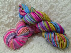 """Museum Grudge Match: New York. Colors inspired by works of art at the MoMA and Guggenheim. This fiber is """"Karneval"""" by cjkoho and """"Cotton Kansinky"""" by Yarn Hollow. The yarn is 100% US Targhee, 2 skeins of 4 ounces each, for 600 yards and 8 ounces total."""